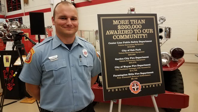 Sgt. Jarod Foshag accepted four AEDs on behalf of the Farmington Hills Fire Department from the Firehouse Subs Public Safety Foundation.