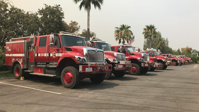 Fire trucks are parked outside the Best Western Plus Hilltop Inn in Redding. Area hotels are filling up with firefighters and evacuees from the Carr Fire.