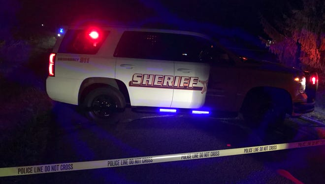 A Henry County sheriff's vehicle early Friday blocks access to Mechanicsburg Road north of Ind. 38. A man reportedly took his own life after fatally shooting a woman and child about 10:30 p.m. Thursday.