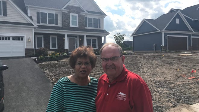 Linda Wilson of GRAR and Rick Herman of Rochester Home Builders' Association at Homearama