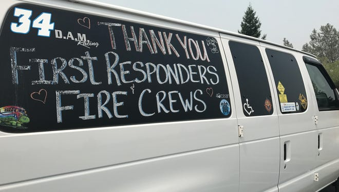 Kristin Matthews of Shasta Lake decorated her van to support Carr Fire first responders. She's been staying home because she's afraid of looters.