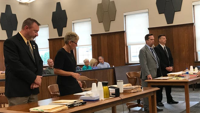 Ex-sheriff's office detective Sean O'Connell, far right, with attorney Chris Fiegl enters a plea of guilty to a third-degree felony tampering with evidence.