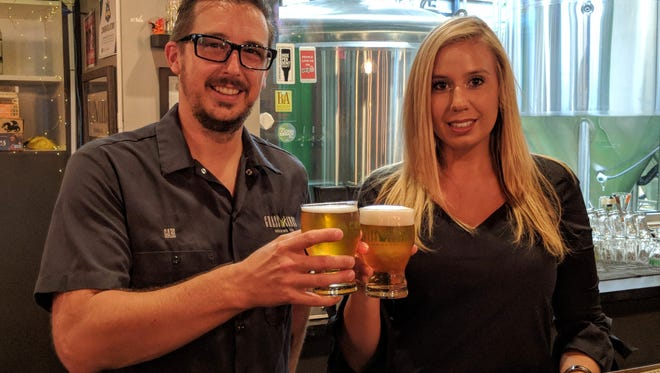 """GrassLands Brewing Company owner Gabe Grass left, and The Elk Institute's Angela Drzewiecki are teaming up for a new charity initiative called """"Community Pint,"""" which begins Aug. 1 and sees a portion of proceeds from a designated GrassLands beer donated at the end of every month. The first charity will be  Drzewiecki's Elk Institute, which provides education, and treatment to the military and veteran community, with a concentration on treating Post Traumatic Stress Disorder."""