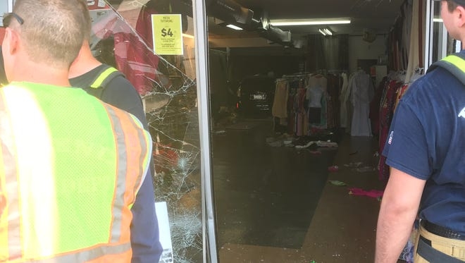 Two children were hospitalized after a car crashed into a Phoenix store.