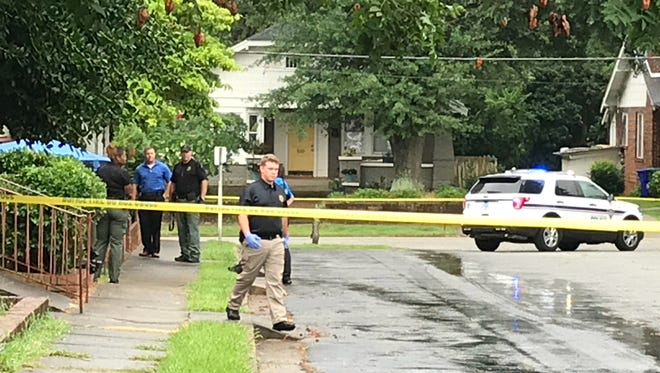 Investigators work the scene of a death investigation after a woman's body was found on Pendleton Street in Greenville.