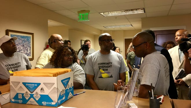 Members of Community Oversight Now drop off a petition signatures at the Metro Clerk's office on Aug. 1, during their campaign to establish a citizen-led police oversight board in Nashville.