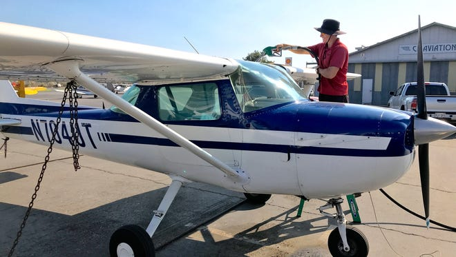 Head lineman with CP Aviation, Anthony Vasquez, fuels a plane at the Santa Paula Airport. The maintenance shop and flight school was mostly closed during the Thomas Fire.