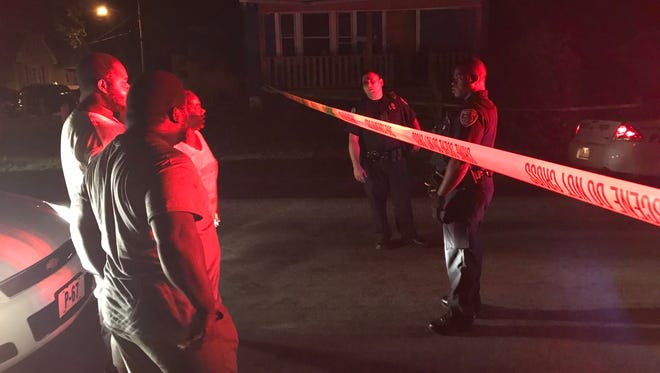 Rochester police and community members on scene of a shooting in the 400 block of Remington Street late Thursday.
