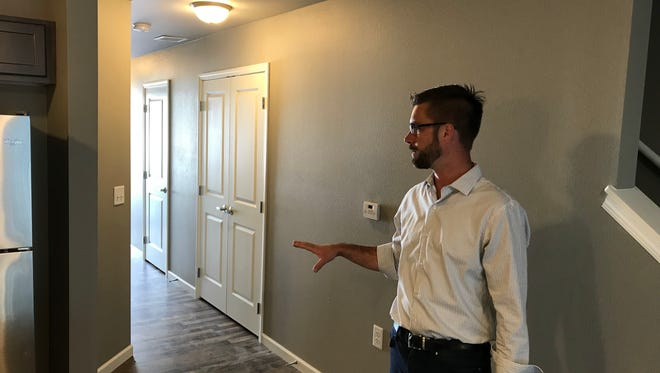 Tyler Arens, who heads Sioux Falls' Affordable Housing Solutions, gives a tour of a town home at the new Field of Dreams development. The 26-unit town home community is located near 15th Street and Sycamore Avenue.