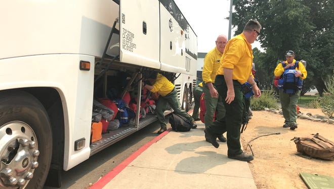 Crews from Australia and New Zealand on Monday arrived in Redding to help battle the Carr Fire and Mendocino Complex.