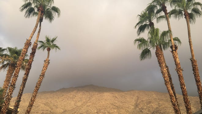 Clouds block the sky above the San Jacinto Mountains in Palm Springs. They're part of monsoonal weather conditions that should last into the weekend, weather officials say.