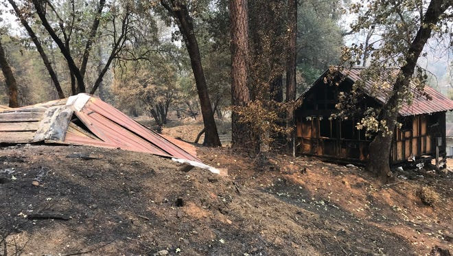 Several of the cabins at the Whiskeytown N.E.E.D. Camp were burned in the Carr Fire. Many other buildings survived the blaze, though.