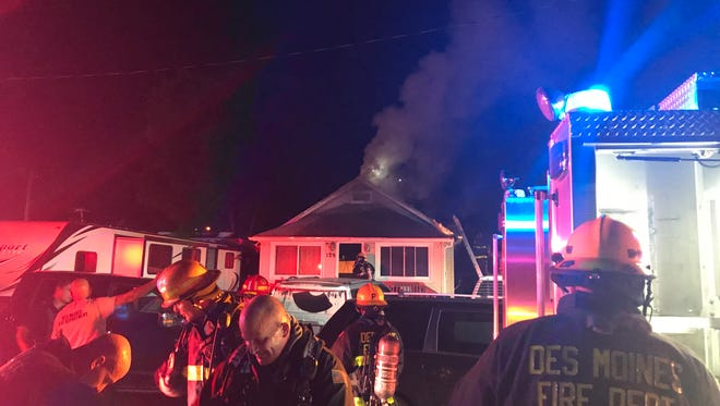Des Moines firefighters put out a fire in the 100 block of East 33rd Street, near the Iowa State Fair, on Friday night.