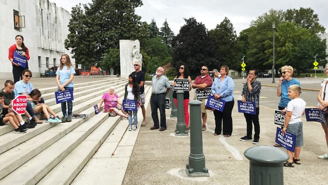 More than a dozen Oregonians attended a Justice 4 Life rally at the Oregon State Capitol Saturday, Aug. 11, in support of President Donald Trump's Supreme Court nominee Brett Kavanaugh.