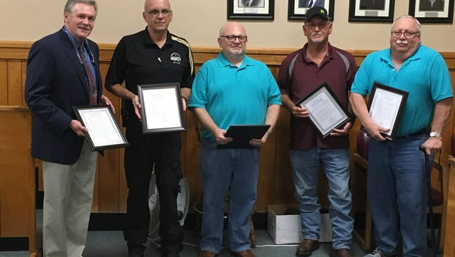 Some out-going members of Stewart County government were recognized for their service at the conclusion of the Aug. 20 County Commission meeting. From left is County Mayor Rick Joiner, Sheriff Deryk Wyatt, County Commissioner Marty Blane, Highway Supervisor Gary Page and County Commissioner Phillip Castile.
