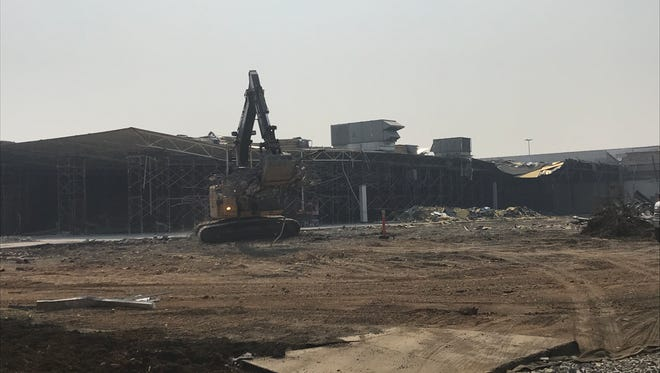 Crews work at demolishing the old Sears department store at the Mt. Shasta Mall in Redding.