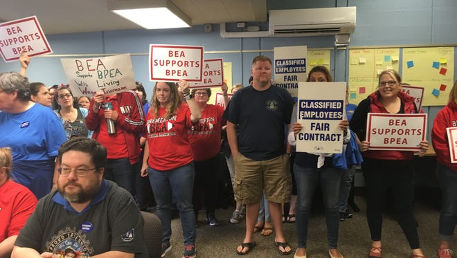 Classified employees and teachers who support their call for higher wages demonstrated before the Bremerton School Board on Thursday.