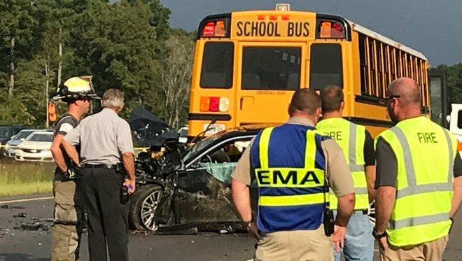 Emergency responders respond to a crash involving two vehicles and a school bus carrying about 55 children in Montgomery County on Friday, Sept. 21, 2018.