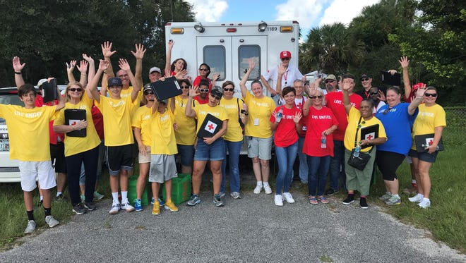Red Cross and United Way volunteers gathered together to install free smoke alarms in St. Lucie County for United Way's Day of Caring.