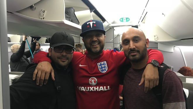 Titans fans Sanket Patel (left), Sreyas Surati (center) and Sandip Patel on board a nonstop British Airways flight from London to Nashville on Oct. 22, 2018. The trio took the direct flight to England's capital to see the Titans play the Charges at Wembley Stadium on Oct. 21 in their first international game.
