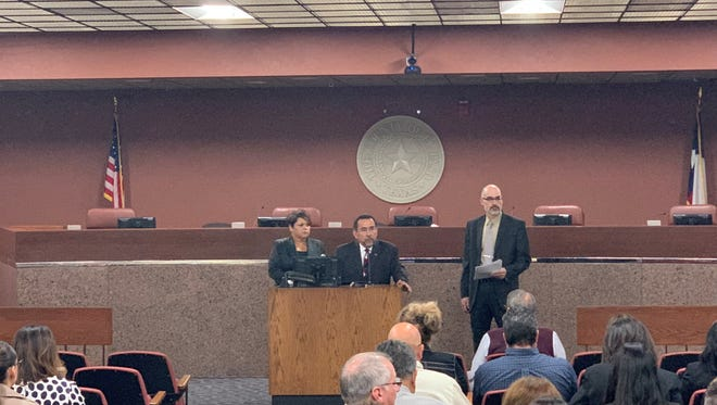 """El Paso County Community Supervision and Corrections Department Director Magdalena Morales-Aina (left), County Criminal Court at Law 2 Judge Robert Anchondo, and Joel Bishop, executive director of Criminal Justice and Community Service of the El Paso County Administration, welcome attendees to the """"Evidence-based practices and judicial decision-making"""" conference Thursday at the El Paso County Courthouse."""