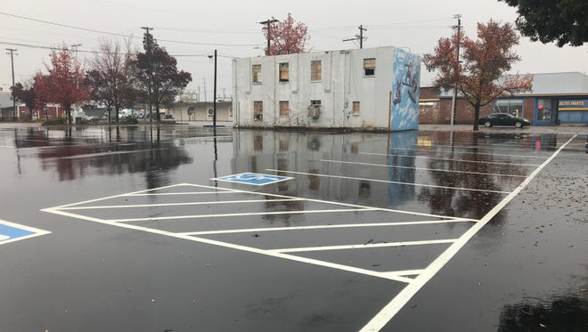 Where an old auto repair and locksmith shop once stood is a new downtown Redding parking lot. The Bell Rooms stand in the background.