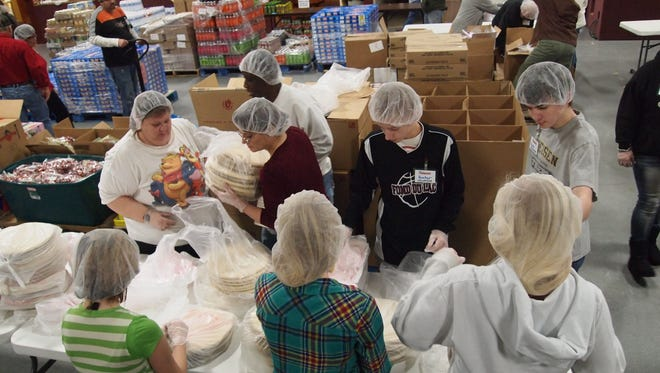 Volunteers assist with sorting a Ruby's Pantry distribution.