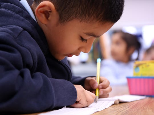 """A kindergartener works on words ending in """"ck"""" at The Ocean Academy Charter School in Lakewood. The school just opened in September. They teach about 160 kids in K-2nd grade. Lakewood, New Jersey. Monday, April 16, 2018."""