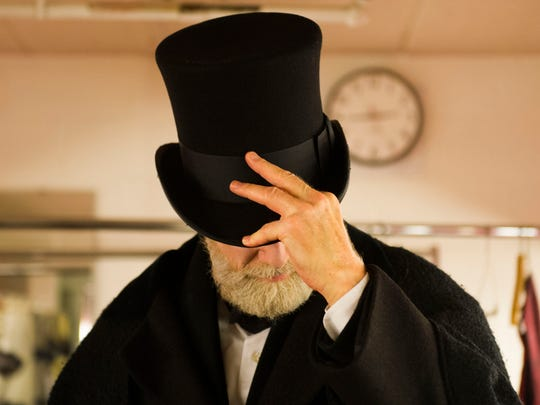 "University of Tennessee professor and Head of Acting Jed Diamond tips his hat while in costume for his character Ebenezer Scrooge from Charles Dickens' ""A Christmas Carol"" in the Clarence Brown Theater at University of Tennessee Thursday, Nov. 7, 2017."