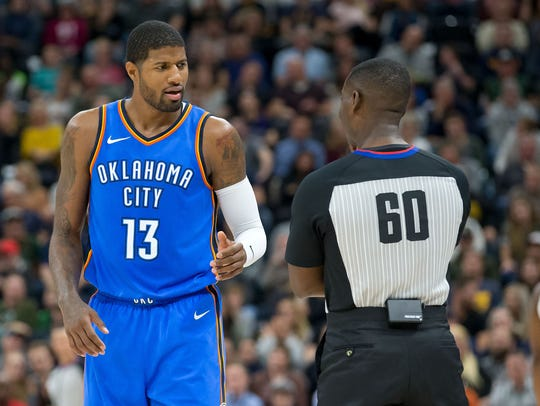 Oklahoma City Thunder forward Paul George (13) talks