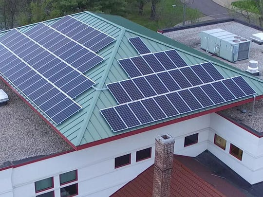 A drone's view of the 2001 addition to the T.B.Scott Free Library in Merrill shows 78 solar panels installed this year.