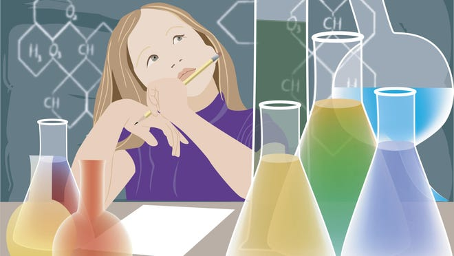 Girl sitting in a laboratory