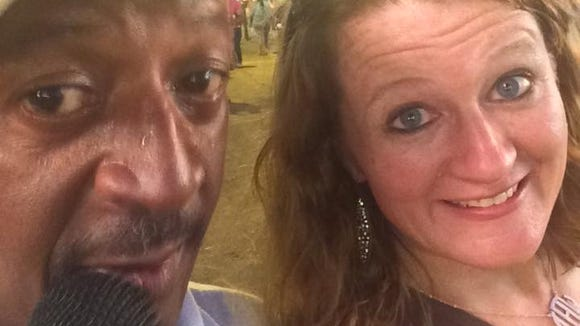 Reporter Therese Apel makes nice with a fair worker who was working the midway.