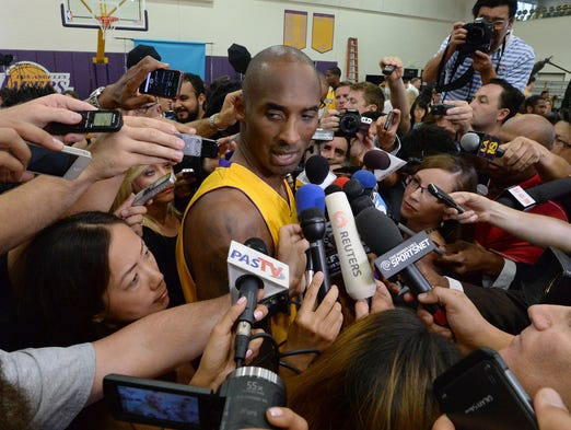 Lakers guard Kobe Bryant answers questions during media day at the team practice facility in El Segundo, Calif.