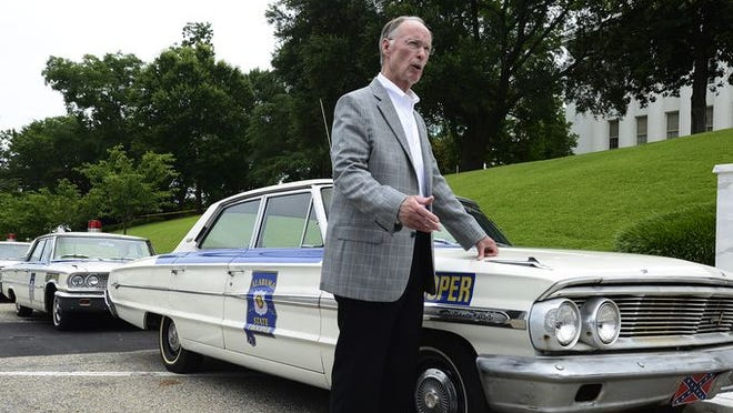 Alabama Governor Robert Bentley gets a close look at period cars to be used in the filming of the Selma movie in front of the state capitol building in downtown Montgomery, Ala. on Friday June 27, 2014.