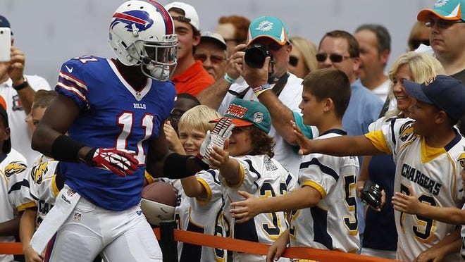 Buffalo Bills wide receiver T.J. Graham (11) greets youth league players before a game at Sun Life Stadium.