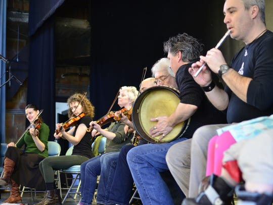 Local musicians with Young Tradition Vermont perform traditional Irish music at the Burlington Irish Heritage Festival at Burlington City Hall on Sunday, March 19, 2017.
