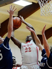 York Country Day's DeAireus Brown shoots through the