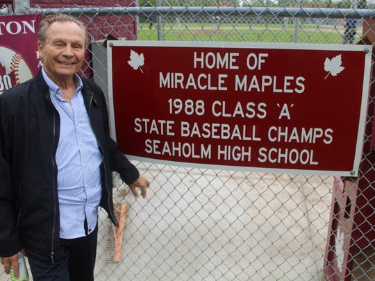 Don Sackett, 85, proudly stands next to the sign at Maple Field which highlights Seaholm's historic 1988 state championship run.
