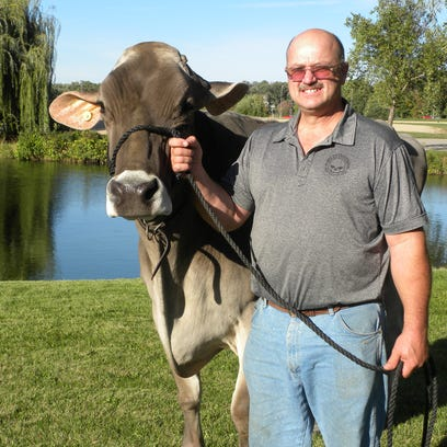 """In 2013 Allan Bassler brought his highly prized veteran of World Dairy Expo """"Snickerdoodle"""" back to Madison at the ripe old age of 15. His special bond with his aged Brown Swiss cow, a former Supreme Champion and two-time Reserve at Expo was evident. She is one of the record breakers we remember on the 50th anniversary of Expo."""