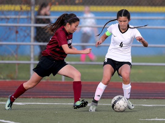 U-Prep's Savannah Leak fights for the ball with Lowell's Shannon Li during the NorCal regional playoffs Thursday in Redding. The Panthers lost the match 2-1.