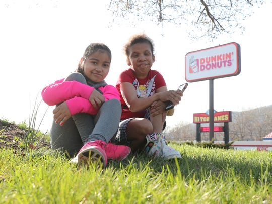 Chelsea Ingram, 25, right, and Gabby Torres, 8, sit