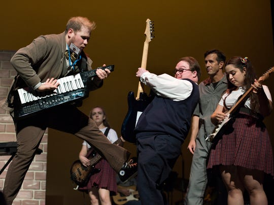 """Guest artist Stephen Schermitzler (Dewey Finn) plays a riff with Detour Company Theatre actor Taylor Ray """"School of Rock"""" at the Scottsdale Center for the Performing Arts."""