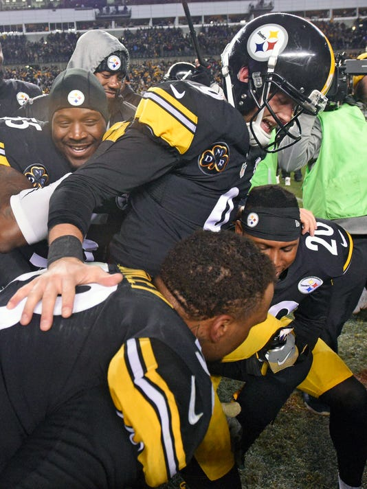 Pittsburgh Steelers kicker Chris Boswell (9) is picked up by Maurkice Pouncey, bottom, and Robert Golden (20) and carried off the field after kicking the game-winning field goal in the second half of an NFL football game against the Green Bay Packers in Pittsburgh, Sunday, Nov. 26, 2017. The Steelers won 31-28. (AP Photo/Don Wright)