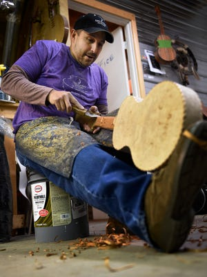 Manuel Delgado of Delgado Guitars works in his shop Jan. 5, 2017, in Nashville. Delgado's father, grandfather and great-uncle also worked as luthiers.
