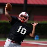 Petal player Jordan Wilson throws a pass during spring football practice on Tuesday at Petal High School.