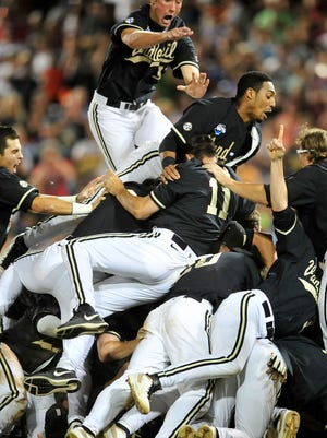Vanderbilt players celebrate their 3-2 win over Virginia, which gave them the College World Series title last season.