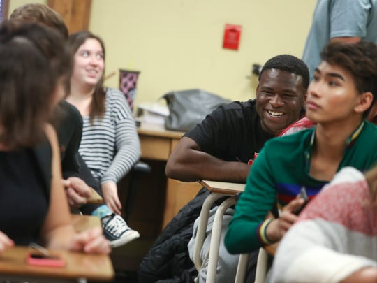 Victor Penn-Nash, center talks with classmates during AP English class Thursday may 30, at Enterprise High School.