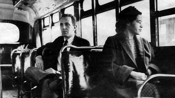 An undated photo shows Rosa Parks riding on the Montgomery Area Transit System bus. Parks refused to give up her seat on a Montgomery bus on Dec. 1, 1955, and ignited a boycott that led to a federal court ruling against segregation in public transportation.