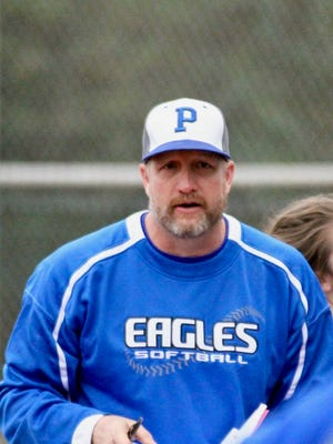 Donald Hart, pictured here with the Lady Eagles Softball team, will now also be the new Lady Eagles Head Basketball Coach.